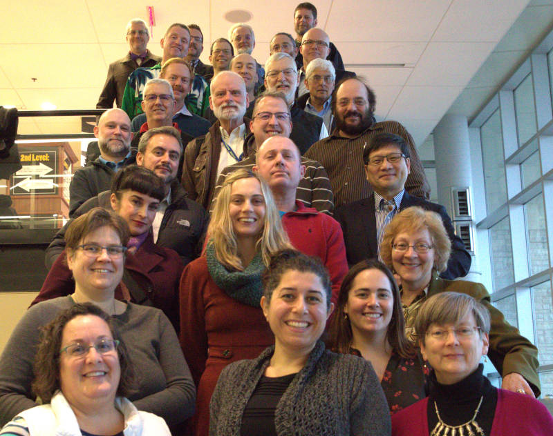 group photo of faculty council on stair steps